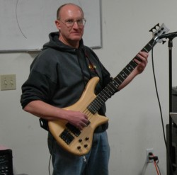Lenny Gemar playing Schecter 5-string bass with the Fully-Covered Band, Feb 2006